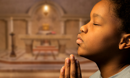 A young DC boy practicing his Catholic Faith at Annunciation Catholic School