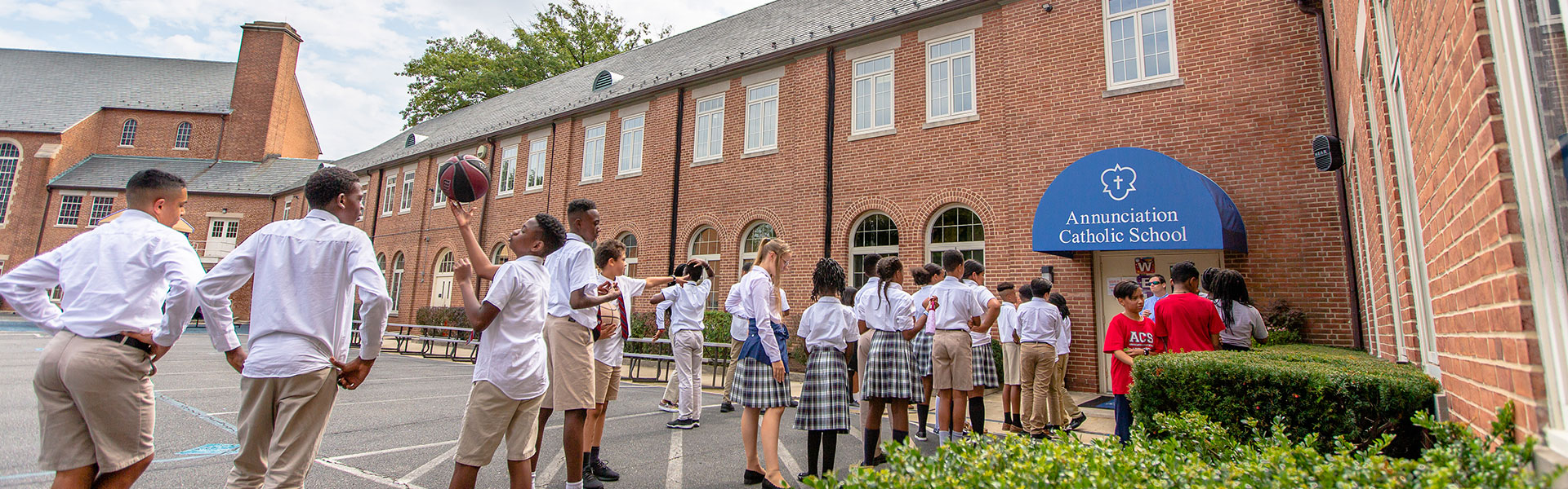 kids playing outside of annunciation catholic school